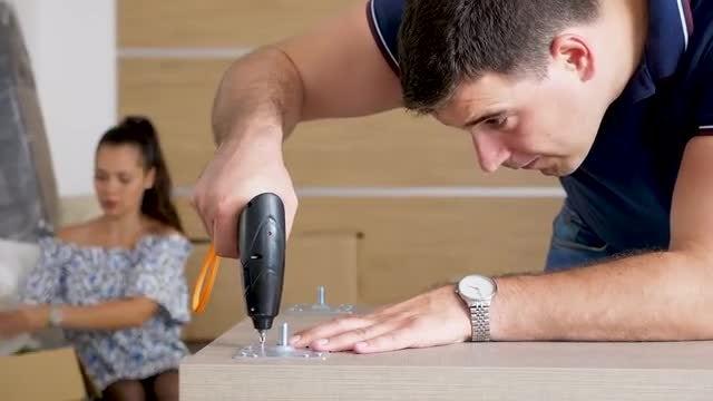 Close-up Of Man Assembling Furniture: Stock Video