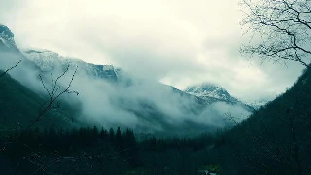 Mountain Covered By White Fog: Stock Video