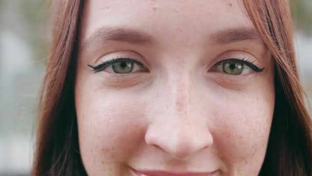 Smiling Woman With Cat-Eye Makeup: Stock Video