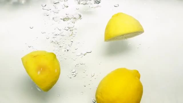 Lemons Dropped Into Water: Stock Video