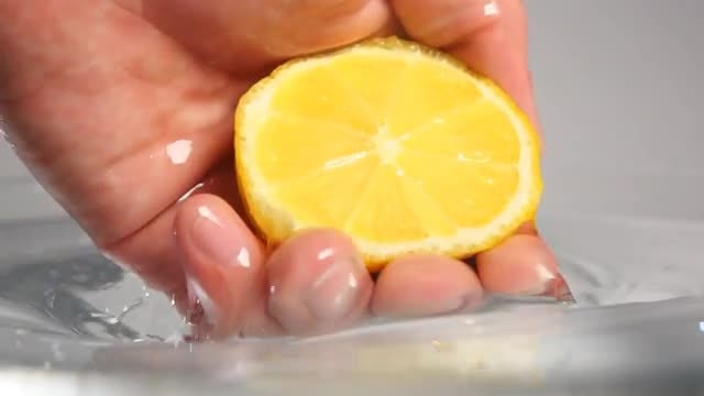 Pulling Lemon Out From Water: Stock Video