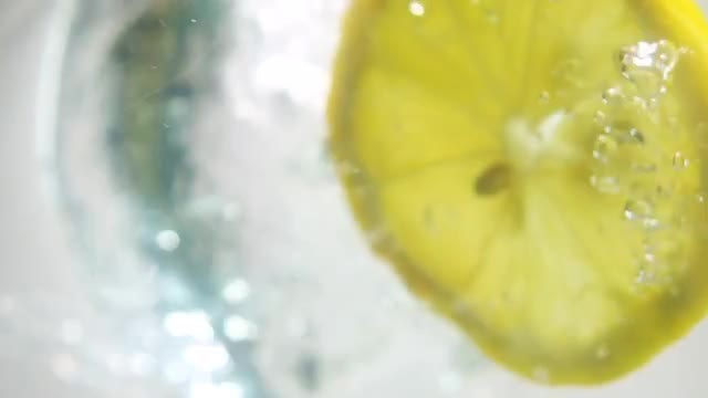 Lemon Slice Falling Into Water: Stock Video