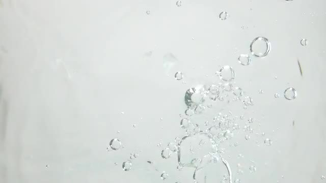 Bullets Shot Through Water: Stock Video