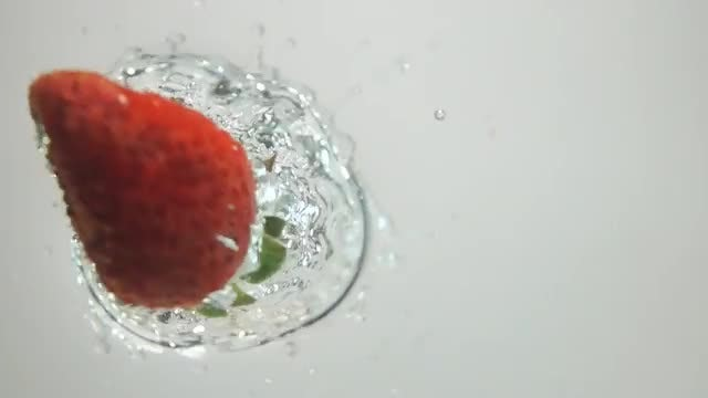 Strawberry Dropped Into Water: Stock Video