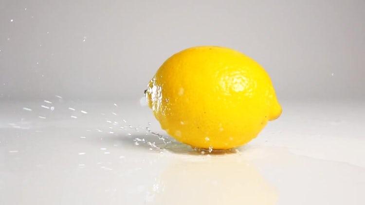 Lemon Falling On Wet Surface: Stock Video
