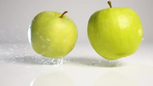 Apples Falling On Wet Surface: Stock Video