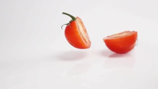 Tomato Splitting Into Two: Stock Video