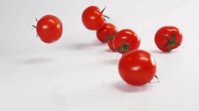 Tomatoes Falling On White Surface: Stock Video