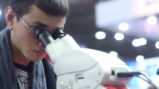 Man Using Modern Laboratory Microscope: Stock Video