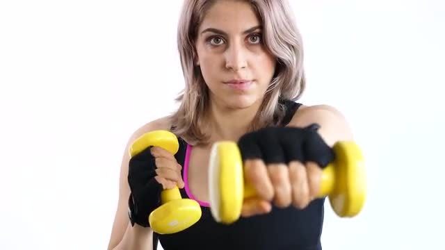 Practicing Punching With Yellow Dumbbells: Stock Video