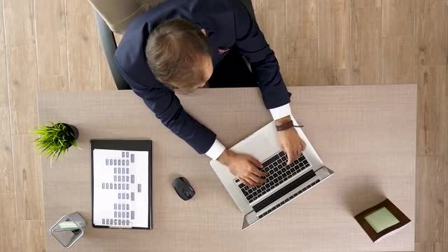 Businessman Sliding On A Chair: Stock Video