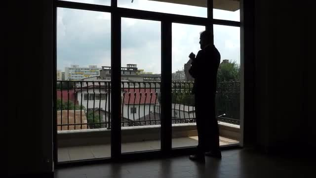 Businessman Thinking By The Window: Stock Video