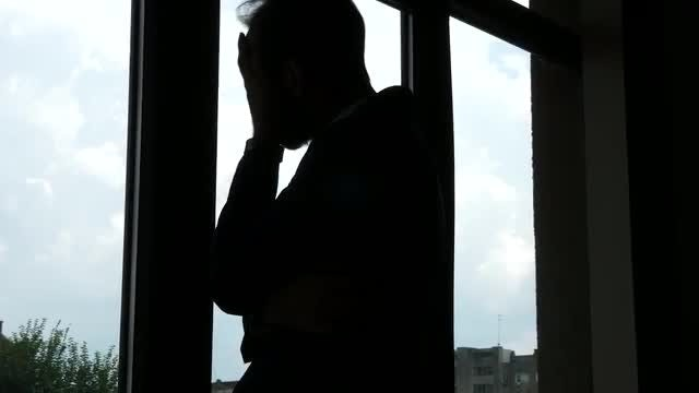 Silhouette Of A Troubled Man : Stock Video