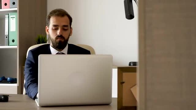 Young Businessman Typing On Laptop : Stock Video