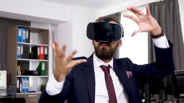 Businessman Using Virtual Reality Headset: Stock Video