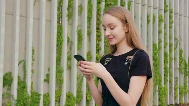 Girl Reading Message On Smartphone: Stock Video
