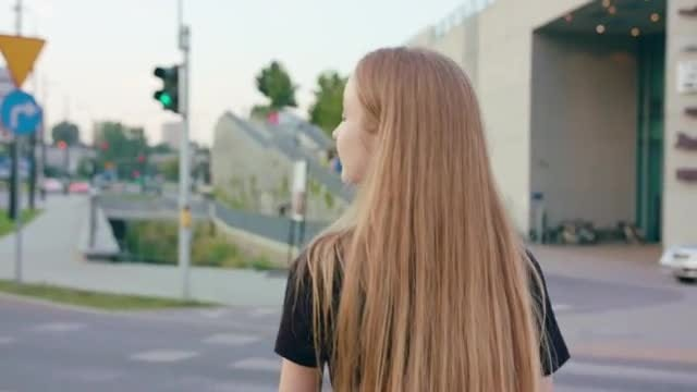 Girl Walking Down The Crosswalk: Stock Video