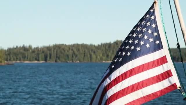 USA Flag Swaying While Sailing: Stock Video