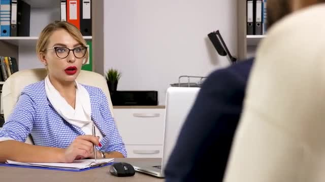 Businesswoman Interviewing A Male Candidate: Stock Video