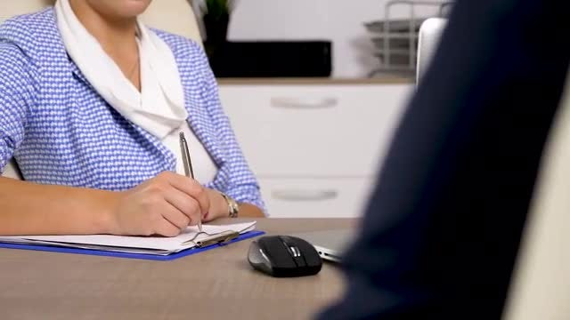 HR Interviewer Takes Candidate Notes: Stock Video