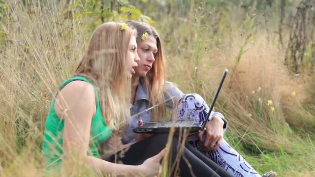 Female Friends With Laptop Outdoors: Stock Video