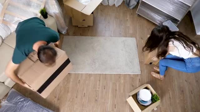 Couple Moving Cardboard Boxes: Stock Video