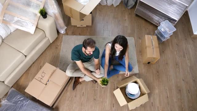 Young Couple Unpack Cardboard Boxes: Stock Video