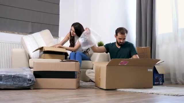 Couple Unpacking In New House: Stock Video
