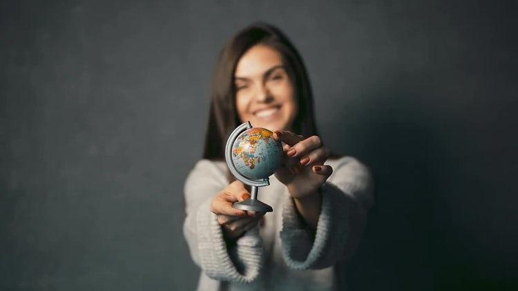 Girl Flips A Spinning Globe: Stock Video