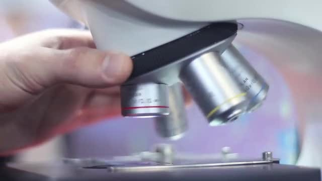 Male Scientist Handling A Microscope: Stock Video