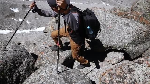 Male Hiker Climbing Up Rocks: Stock Video