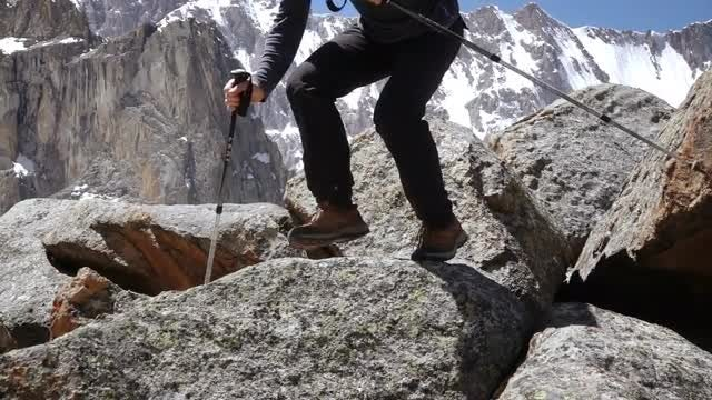 Mountaineer Jumping From Large Rock: Stock Video