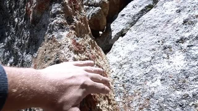 Hiker's Hand On A Rock: Stock Video