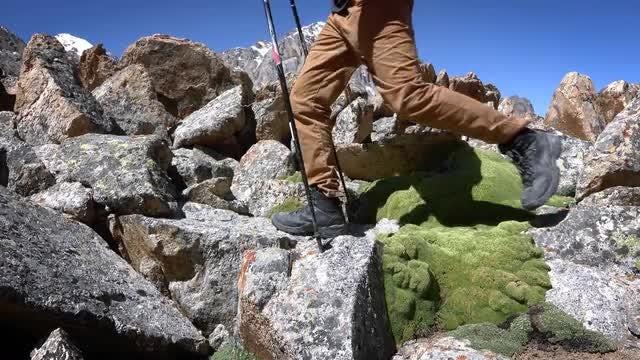 Climber Treks Through Mountain Rocks: Stock Video