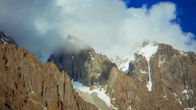 Icy Mountain Peaks During Daytime: Stock Video