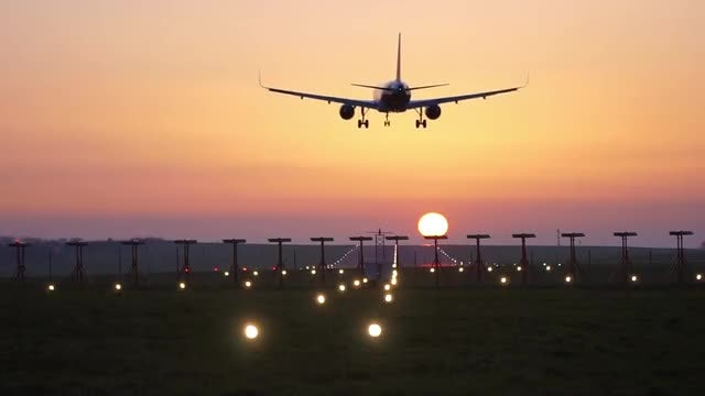 Airplane Landing At Sunset : Stock Video
