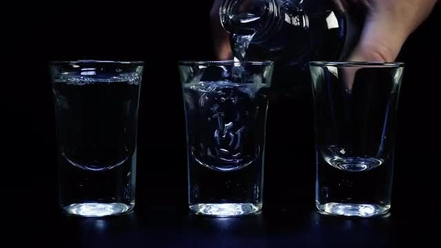 Pouring Three shots Of Vodka: Stock Video