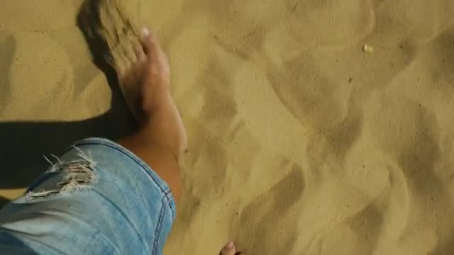Man Walking On Sand : Stock Video