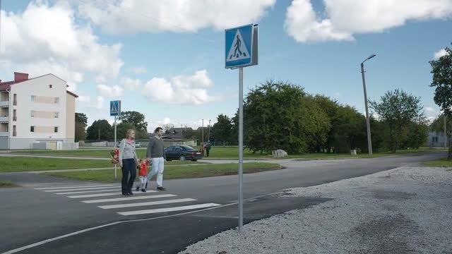 Family Of Three Crosses Road: Stock Video