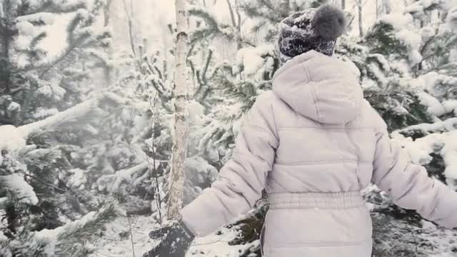 Girl Running Through Winter Forest: Stock Video