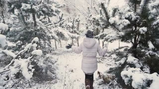 Girl Running Through Snowy Woods: Stock Video