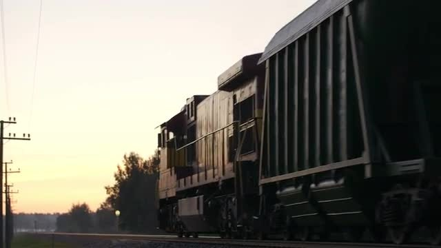 Freight Train Passing By Countryside: Stock Video