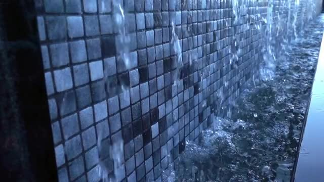 Water Flowing Down Colored Wall: Stock Video