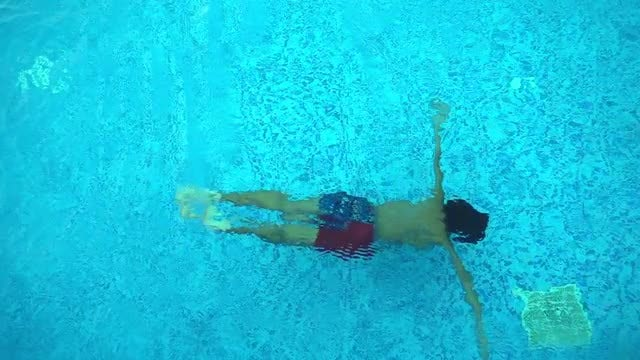 Young Boy Swimming In Pool : Stock Video
