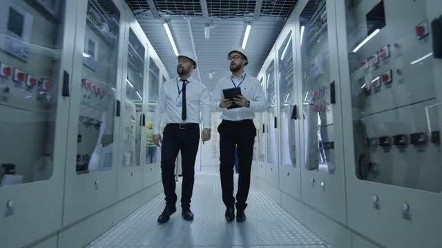 Colleagues Entering A Control Center: Stock Video