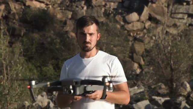 Man Controlling Drone: Stock Video