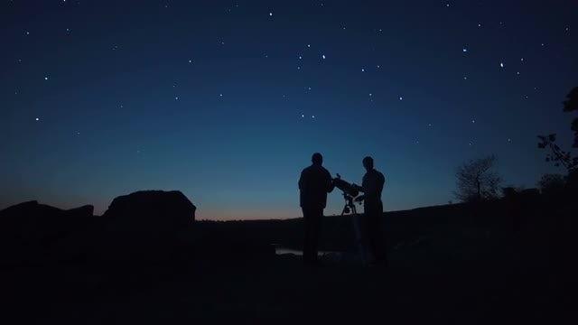 Men Use A Telescope: Stock Video