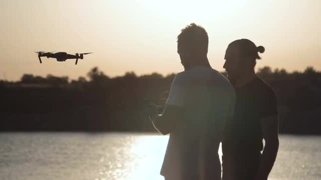 Men Control Drone: Stock Video