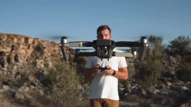 Man Controlling A Drone: Stock Video