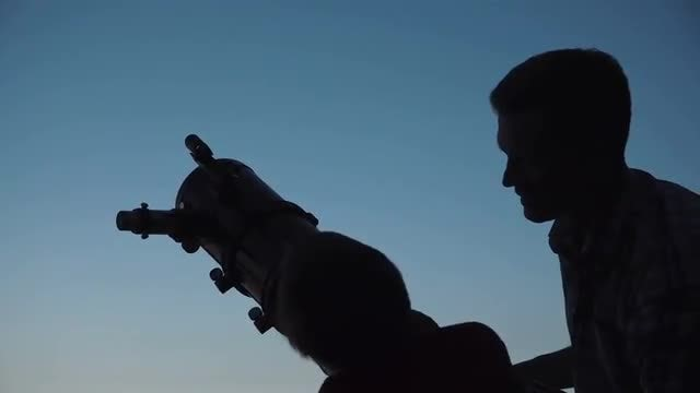 Father And Son Use Telescope: Stock Video